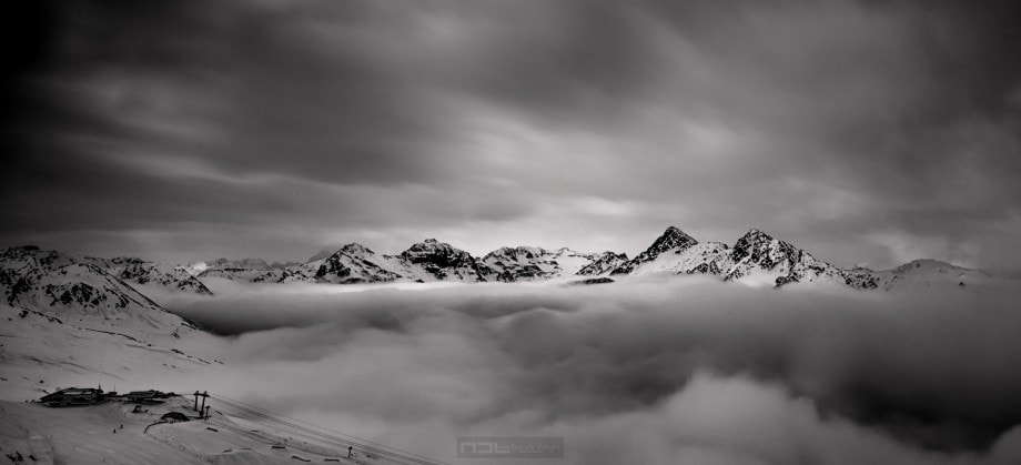 misty black and white landscape of mountain peaks