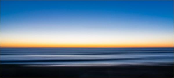 Impressionist seascape with blue and orange hues