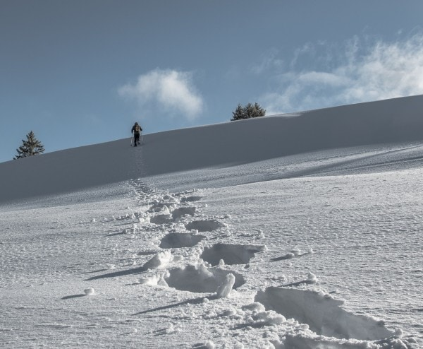 landscape of a person taking a journey over snow covered mountains