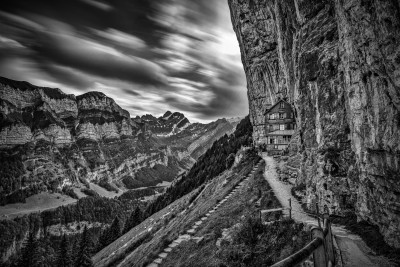 black and white landscape of a hotel on a cliff