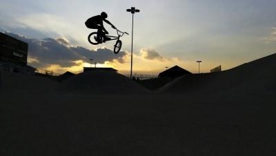 a bmx rider casts a silhouette over a skatepark in edenvale gauteng.