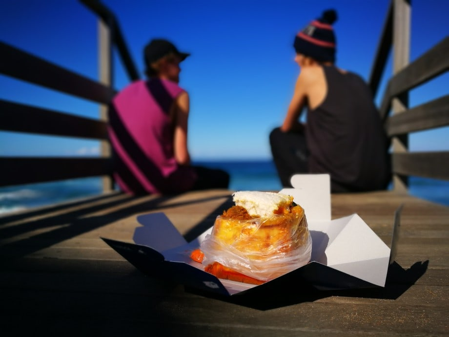 kids about to enjoy their bunny chow, a curried meat dish served in a half loaf of bread. umhlanga, kzn.