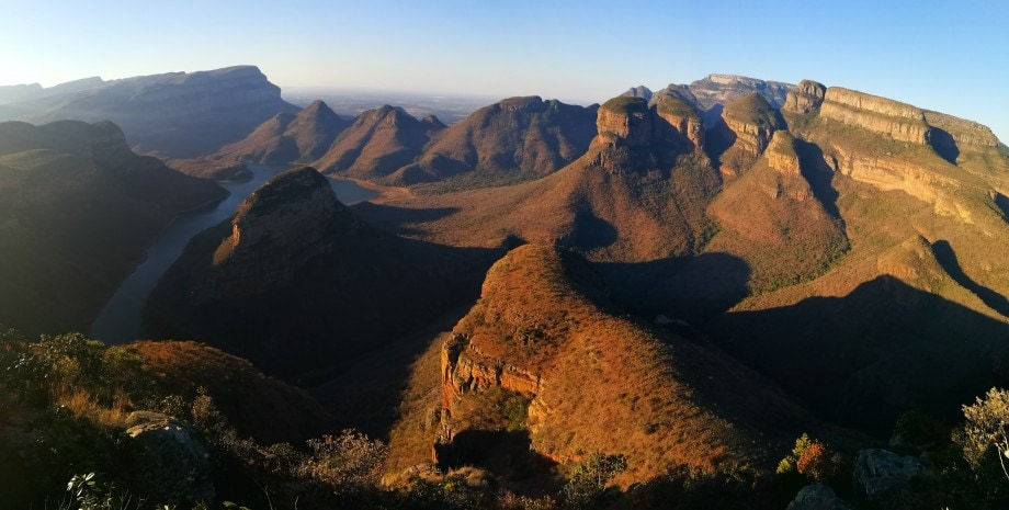a well-known hiking trail, the blyde river canyon, looking spectacular in the afternoon's last golden light. mpumalanga