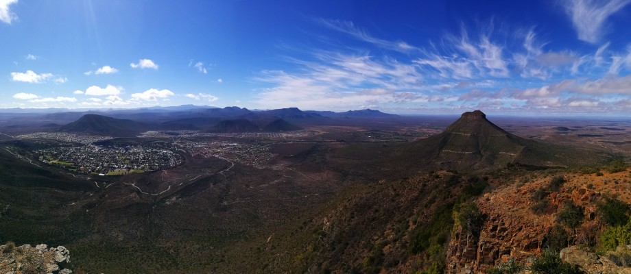 graaf reinet on the left with the peak of spandaukop to the right shot as a panorama, eastern cape.