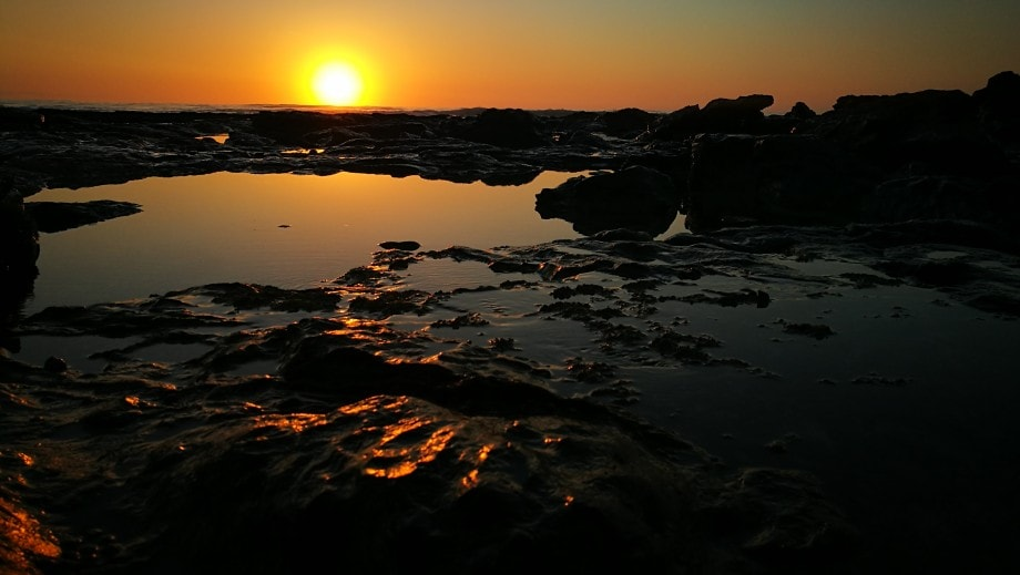 rock pools in jeffreys bay peacefully await a new day. eastern cape