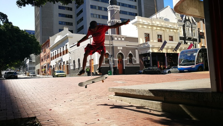 kickflipping in long street in the centre of cape town's city bowl. western cape.